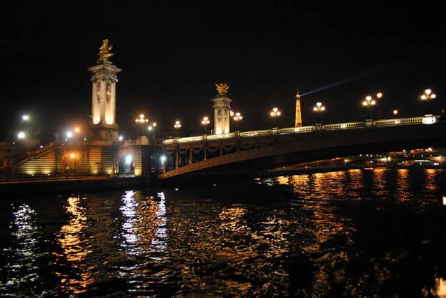 Paris bridge by night